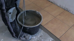 Hand mix tile cement with machine tool at kitchen Stock Footage
