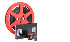 old reel of film, video tape and memory card - stock photo