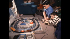 Bothers with Toy train set 1950's Stock Footage