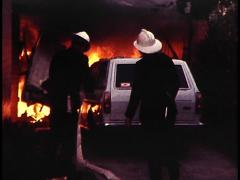 FIREFIGHTERS FIGHT GARAGE FIRE Stock Footage