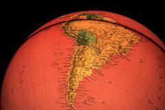 South america on red world globe illuminated from within Stock Photos
