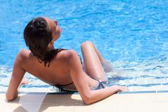 Relax in swimming pool - stock photo
