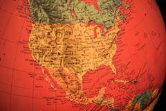 Usa on red light world globe illuminated from within Stock Photos