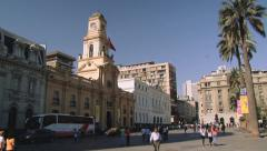 People walk by Plaza de Armas in Santiago, Chile. Stock Footage