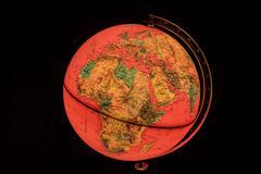 africa on world globe illuminated from within - stock photo