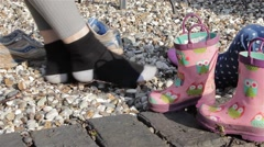 Close Up Adult & Child Nosily Scraping Gravel with Shoes off Socks on (audio) Stock Footage
