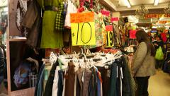 Cheap garments shop in the market, chinatown, price tag in HKD Stock Footage