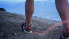 Runner walking by the lake - slow-motion Stock Footage