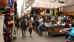 Walking slowly on the street market, garments section - stock footage
