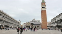 Tourists stroll the piazza at St. Marks Cathedral, Venice, Italy Stock Footage