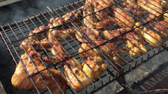 Chicken wings grilling Stock Footage