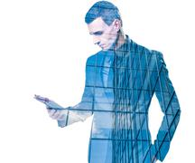 Double exposure of a businessman holding a tablet and an office building over Piirros