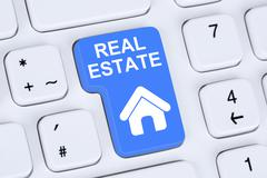 Selling or buying a real estate home icon online on the computer - stock photo