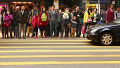 Pedestrian crosswalk on the road. Waiting green light, then crossing the street Stock Footage