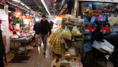 Quick side view of the walkway of indoor food (fish & meat) market Stock Footage
