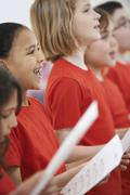 Group Of Children Singing In Choir Together Stock Photos