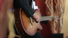 Bearded man plays guitar under approach  move away conditions Stock Footage