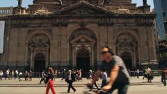 People walk in front of the Metropolitan Cathedral of Santiago, Santiago, Chile. Stock Footage