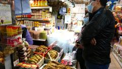 Couple choosing spices in the market, fish section Stock Footage