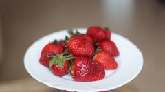 Beautiful strawberries on the rotate table Stock Footage