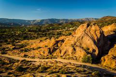 Rocks and view of distant mountains at Vasquez Rocks County Park, in Agua Dul - stock photo