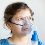 Stock Photo of girl with asthma inhaler