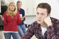 Mature Parents Frustrated With Adult Son Living At Home Stock Photos