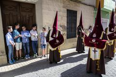Set of boys watching Holy week procession, Spain - stock photo