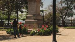 People stand in front of the monument to Don Pedro de Valdivia, Santiago, Chile. Stock Footage