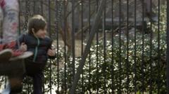 Boy Swinging on Playground Swings - Happy in Park Cute Kid - Cinematic Child 4K Stock Footage