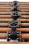 Oil and gas pipeline valves on a piping Stock Photos