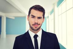 Composite image of portrait of a skeptical businessman well dressed Stock Photos