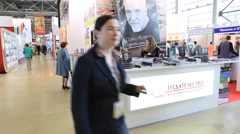 MOSCOW, RUSSIA - 2012: International Book Fair, booth and visitors Stock Footage