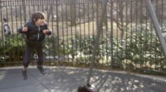 Boy Swinging on Playground Swing in Slow Motion - Happiness and Fun Park NYC 4K Stock Footage