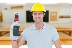 Composite image of confident carpenter holding cordless drill machine - stock photo