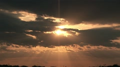 Sun rays penetrate through clouds-timelapse Stock Footage