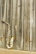 Saxophone Wooden fence - stock photo