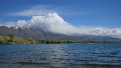 New Zealand Cromwell Lake Dunstan cloud on snow capped hills - stock footage