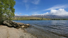 New Zealand Cromwell Lake Dunstan rocky outcrop and beach Stock Footage