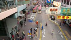 City street from top point, minibus parking far away, pedestrian crossing road Stock Footage