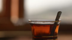 Turkish tea. Sugar droping in to tea and mixing it with spoon. Stock Footage