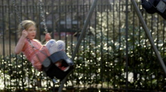 Boy Girl Children Swings Playground slow motion Swinging Park Laughing 4K NYC - stock footage