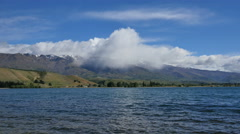 New Zealand Cromwell Lake Dunstan cloud spreads across hills Stock Footage