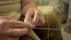 Senior Woman Knitting and crocheting closeup Version 1 Stock Footage