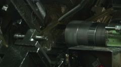 Stock Video Footage of Multi spindle turning lathe, processing and manufacturing of metal elements.