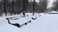Zhekeznodorozny.Russia. Winter day in smal Russian town. Bench covered with Stock Footage