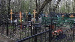 Stock Video Footage of Russian cemetry inside. Graves, Crosses and monuments.