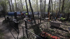 Russian cemetry inside. Graves, Crosses and monuments. - stock footage