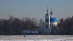ZHELEZNODOROZNIY.RUSSIA - 2013: Orthodoxy church on the snow field Stock Footage
