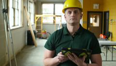 Portrait of a Contractor on a job site Stock Footage